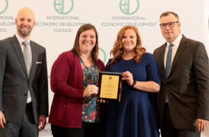 Mallory Hollis and Tiffany Tate with IEDC Move Up Award